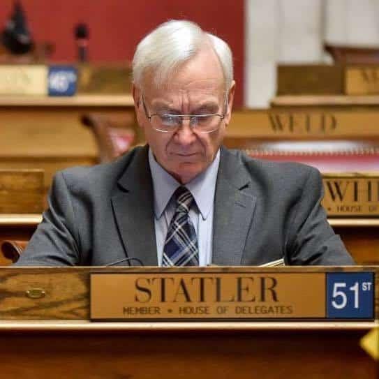 Delegate Joe Statler sits at his desk in the WV Capitol.